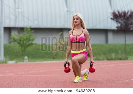 Athletic Woman Workout With Kettle Bell Outdoor