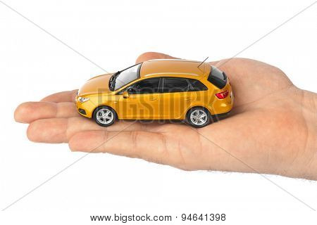 Hand with car isolated on white background