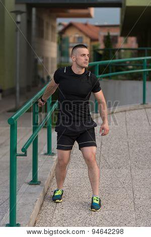 Young Sportive Man Doing Gymnastics Outdoors