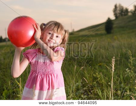 Girl Playing With A Red Ball In The Park