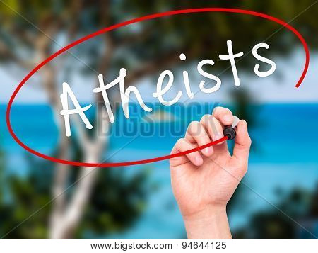 Man Hand writing Atheists with black marker on visual screen.