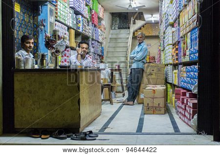 JODHPUR, INDIA - 16 FEBRUARY 2015: Three Indian men in textile store.