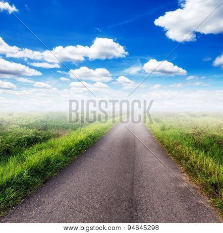 Country Road  On Field And Blue Sky With White Clouds