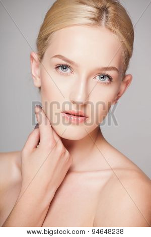 Fashion blonde woman with beautiful face - isolated on white. Skin care concept.