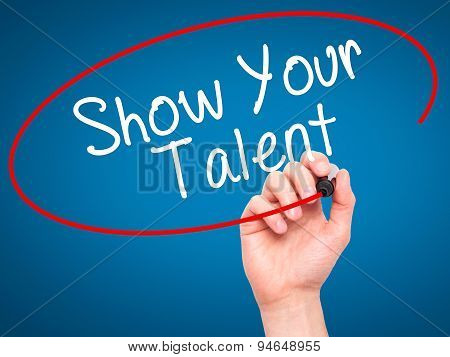 Man Hand writing Show your Talent with black marker on visual screen.