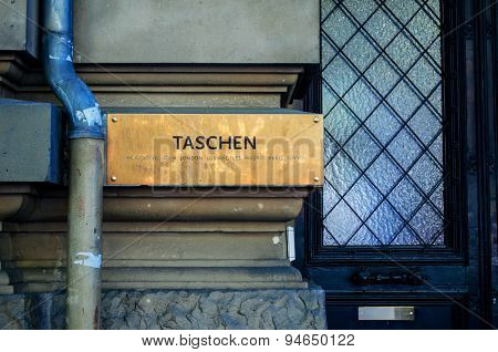 Taschen Book Publisher Headquarters Signage In Cologne