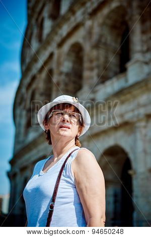 Woman tourist on the background of the Colosseum in Rome