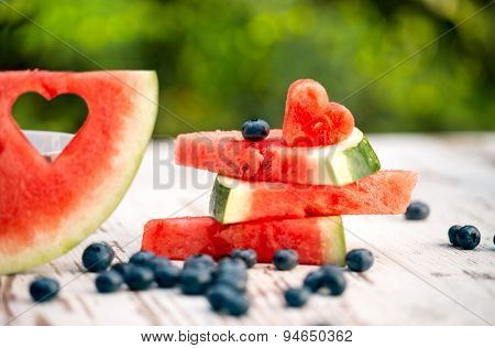 watermelon slices with love decorate on a wooden table