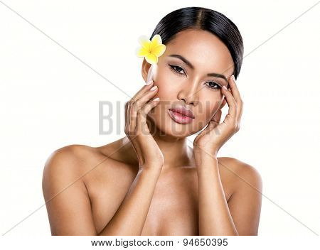 Beautiful Balinese woman with perfect skin, isolated over white