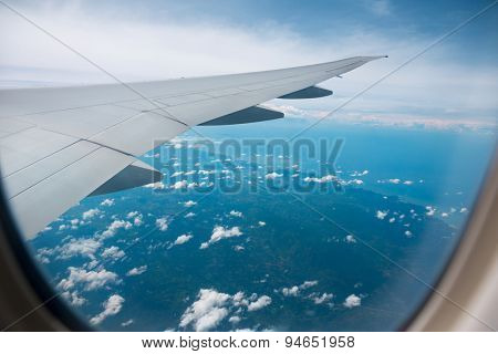 Blue sky view from the airplane window