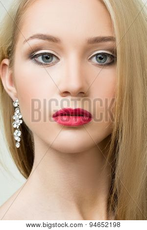 beautiful girl with red lips and earrings. fashion photo