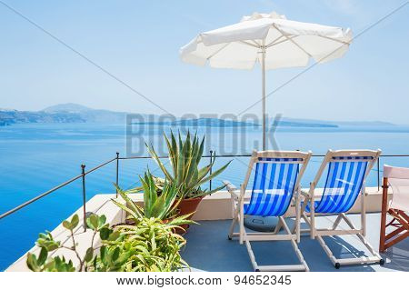Deck Chairs On The Terrace With Sea View