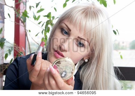 Young Attractive Woman Applying Lipstick
