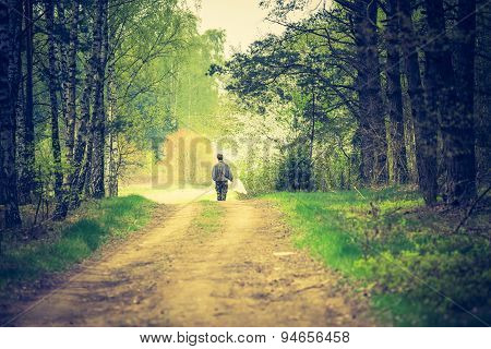 Man Walking By Forest Path