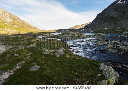High Altitude Alpine Lake And Stream At Sunset