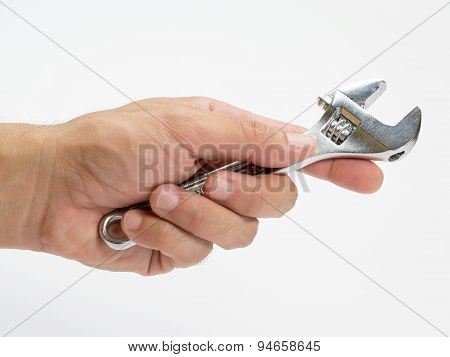 Locking pliers in the mechanics hand.