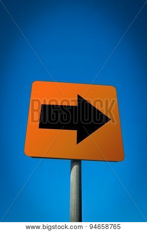 A black arrow red sign