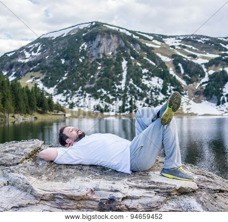 Relaxed man in mountain