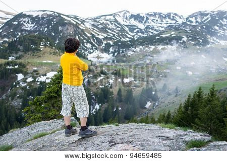 Child exploring the mountain