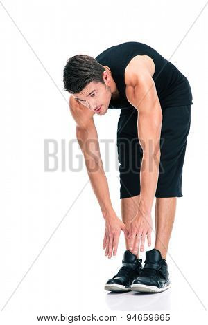 Full length portrait of a sports man doing exercises for warm up isolated on a white background