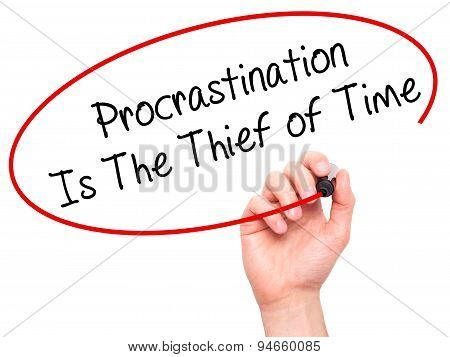 Man Hand writing Procrastination Is The Thief of Time with black marker on visual screen.