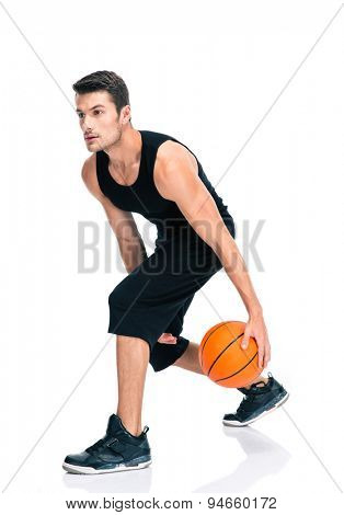 Full length portrait of a sports man playing in basketball isolated on a white background