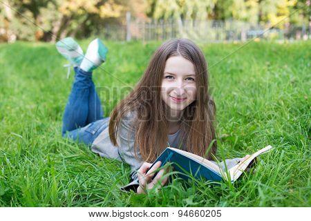 Student Lying On Grass