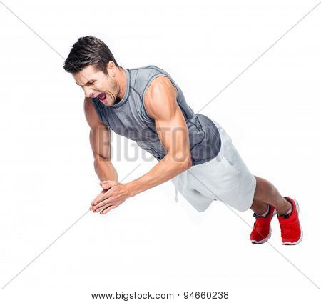 Fitness man doing exercises on the floor and screaming isolated on a white background