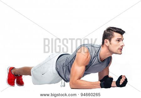 Fitness man doing exercises on the floor for abdominal muscles isolated on a white background