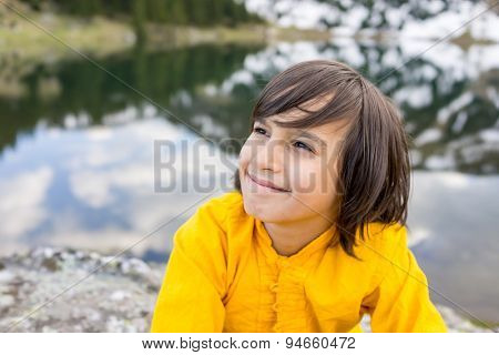 Little boy enjoying in vacation to mountain