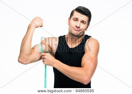 Fitness man measuring his biceps isolated on a white background. Looking at camera