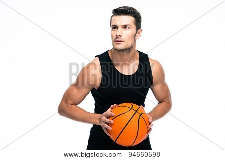 Portrait of a handsome man playing in basketball isolated on a white background