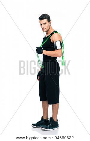 Confident fitness man holding skipping rope isolated on a white background. Looking at camera