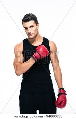 Handsome sports man with boxing gloves isolated on a white background. Looking at camera