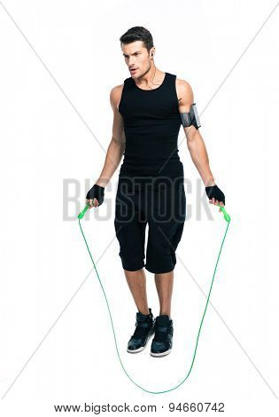 Full length portrait of a handsome man jumping with skipping rope isolated on a white background