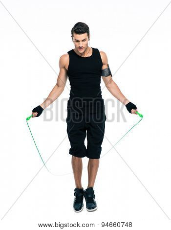 Sports man jumping with skipping rope