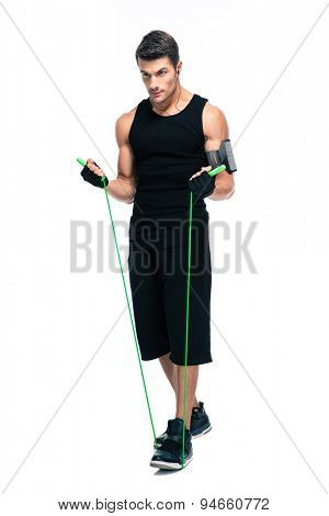 Full length portrait of a handsome man with skipping rope isolated on a white background