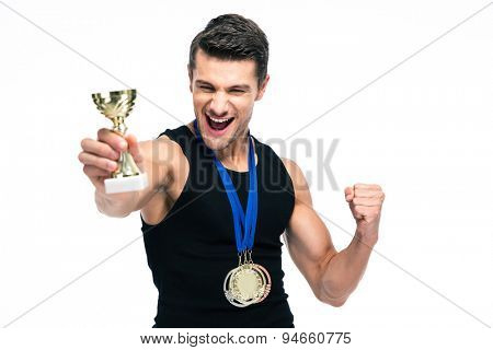 Cheerful sports man holding winner cup isolated on a white background