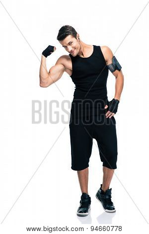 Full length portrait of a happy fitness man showing his biceps isolated on a white background