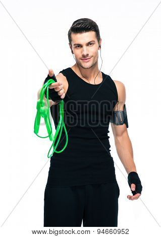 Sports man holding skipping rope isolated on a white background. Looking at camera
