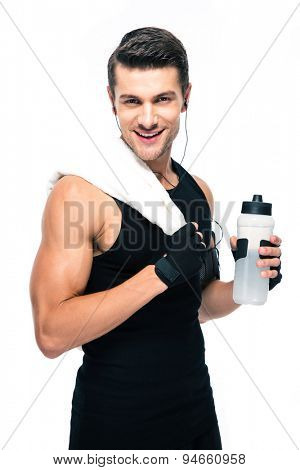 Happy sports man holding towel and bottle with water isolated on a white background. Looking at camera