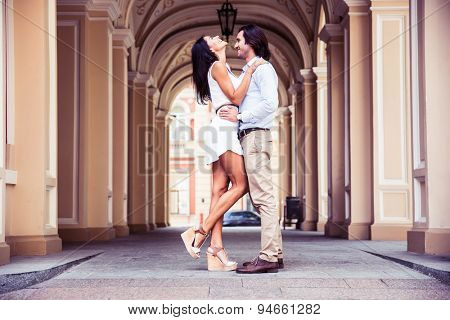 Happy beautiful couple having fun in the european city