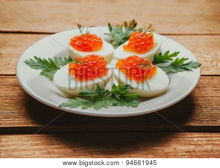 Boiled Eggs Half With Red Salmon Caviar