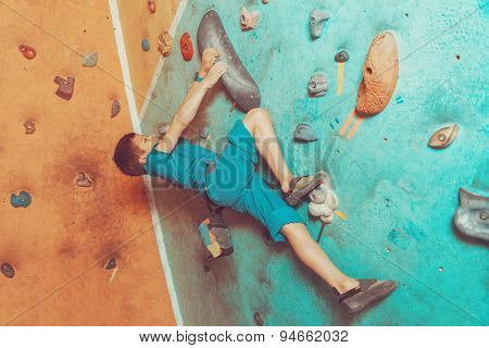Free Climber Boy Exercising In Gym
