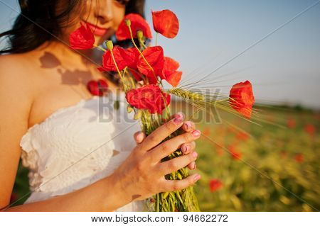 Pregnant Gorgeous Brunette Woman On The Field With Wheat And Poppies On Sunset