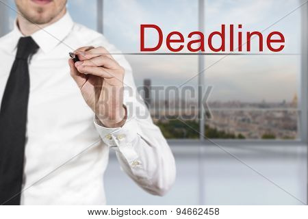 Businessman Writing Deadline In The Air Office