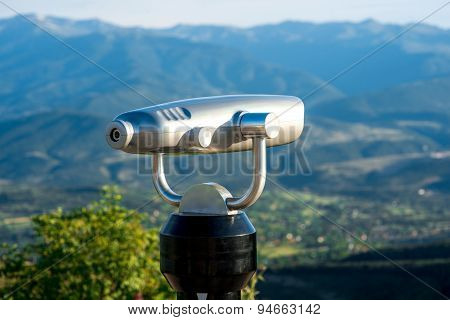 Spyglass on the mountain background