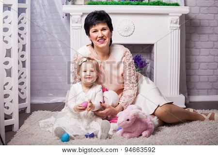 Child and grandmother with Easter eggs