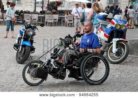 France, Avignon - July 1, 2014. Young Man Disabled Person Sits In A Wheelchair. Aix-en-provence Is A
