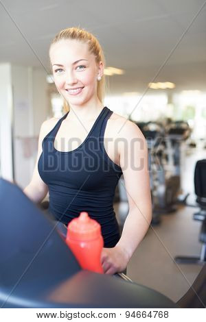 Cheerful Fit Woman On Treadmill Smiling At Camera